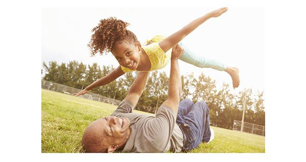 Image of girl and her dad playing outside